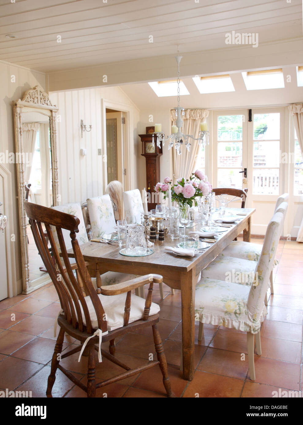 Antique Windsor Carver Chair And Chairs With Loose Covers At Simple Wooden  Table Set For Lunch