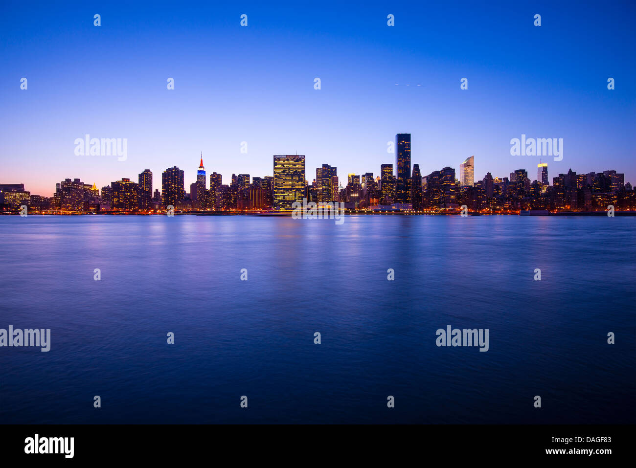 Midtown Manhattan skyline across the East River in New York City. Stock Photo