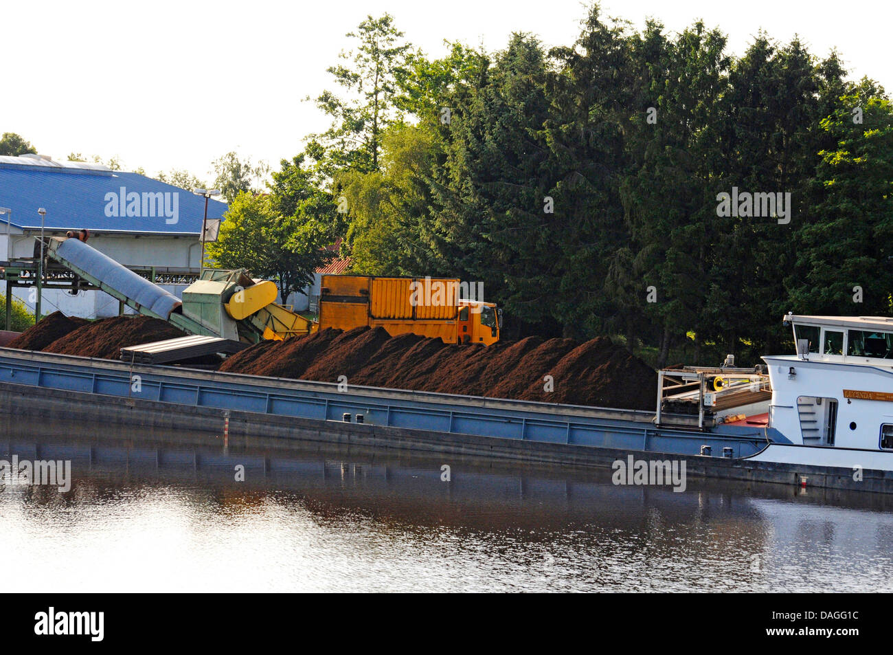 cargo ship loaded with peat in inner harbor of Bockhorst, Germany, Lower Saxony, Emsland, Bockhorst Stock Photo