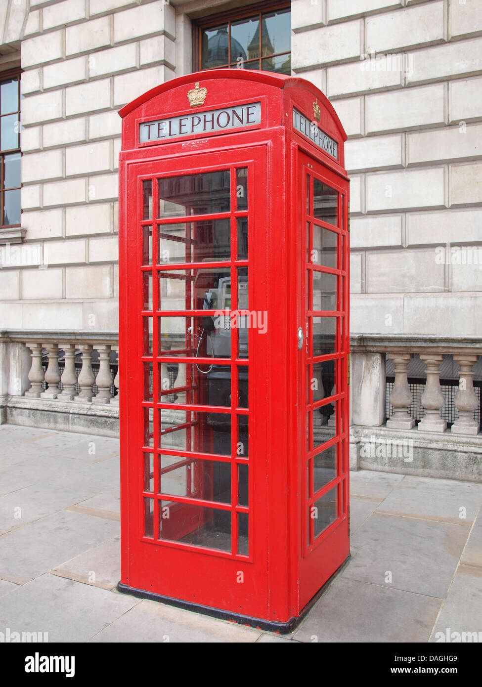 Traditional red telephone box in London UK - Stock Image