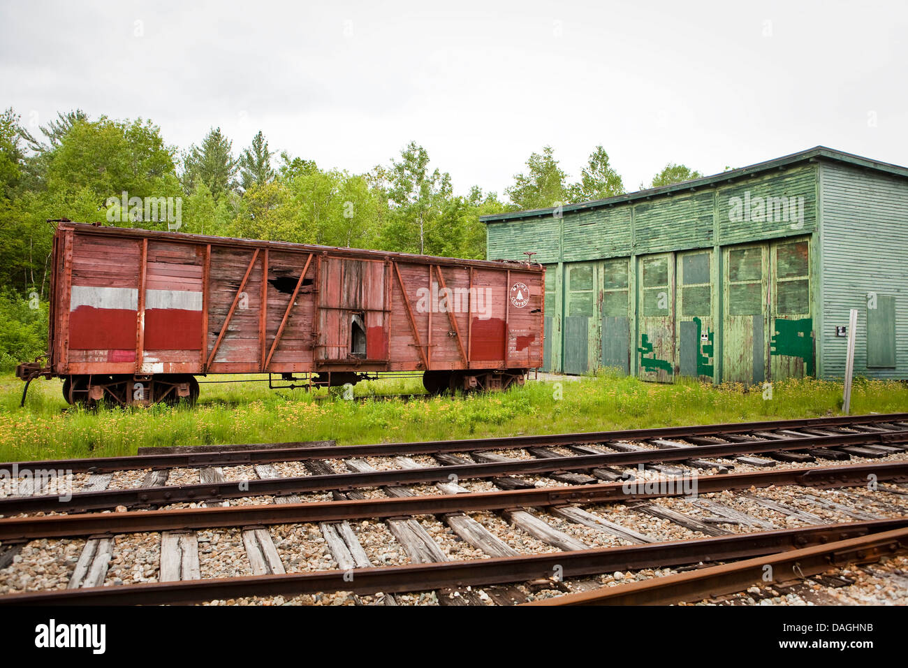 An abandoned railroad car of the Maine Central Railroad Company is seen at the Bartlett Roundhouse in Bartlett, - Stock Image