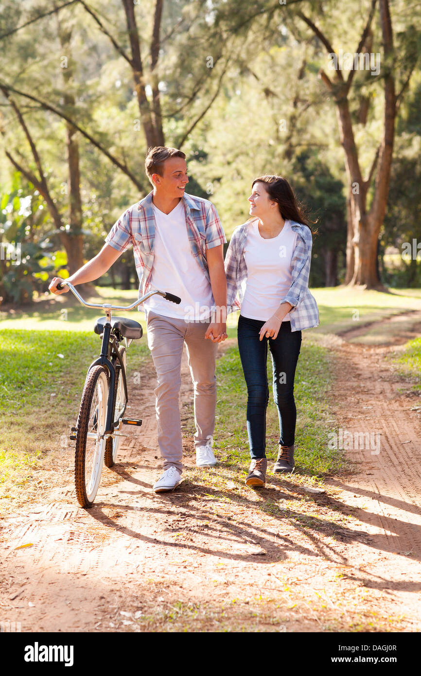 beautiful young teenage couple walking at the park - Stock Image