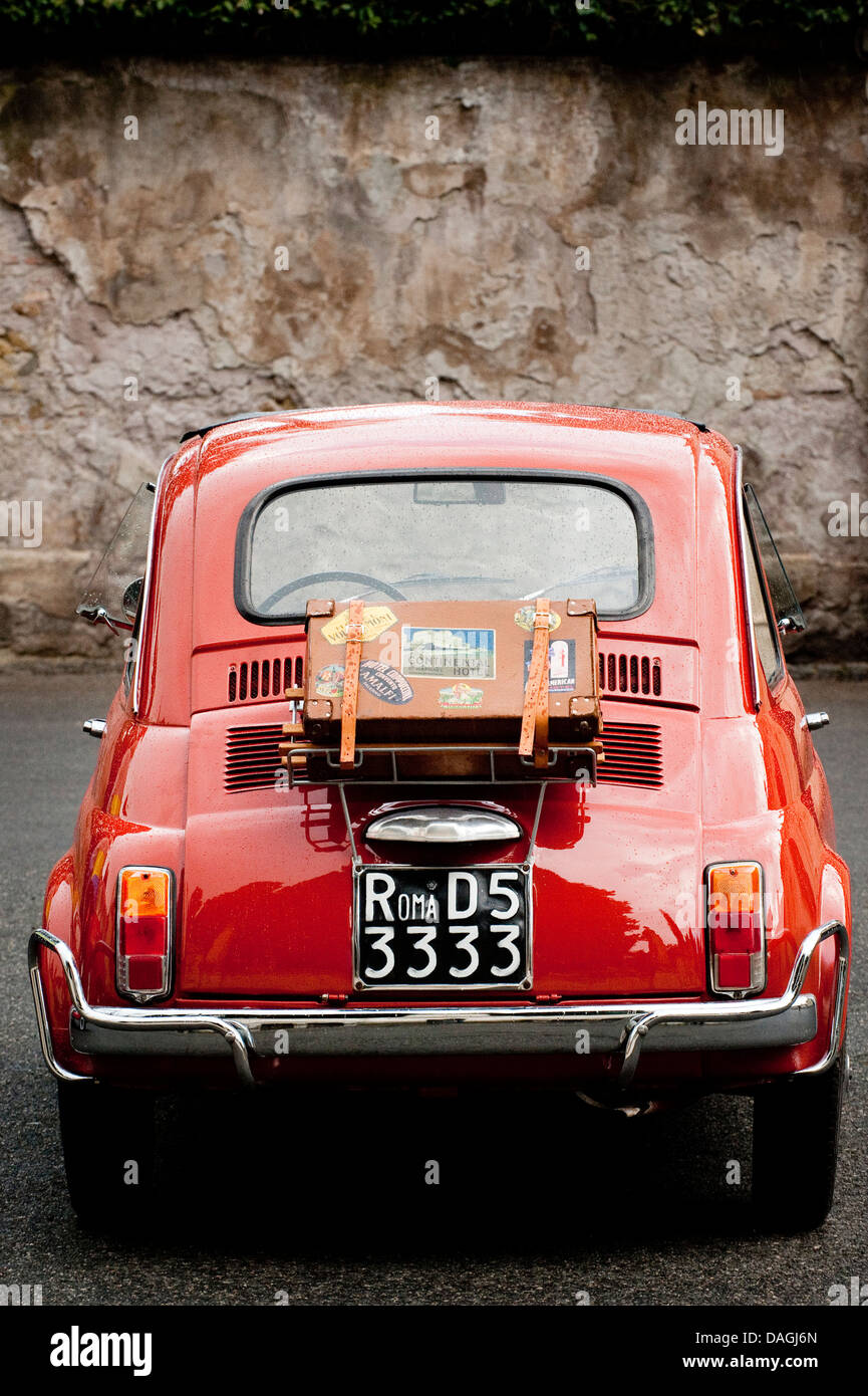 Vintage orange Fiat Bambino 500 parked in the streets of Rome, Italy - Stock Image