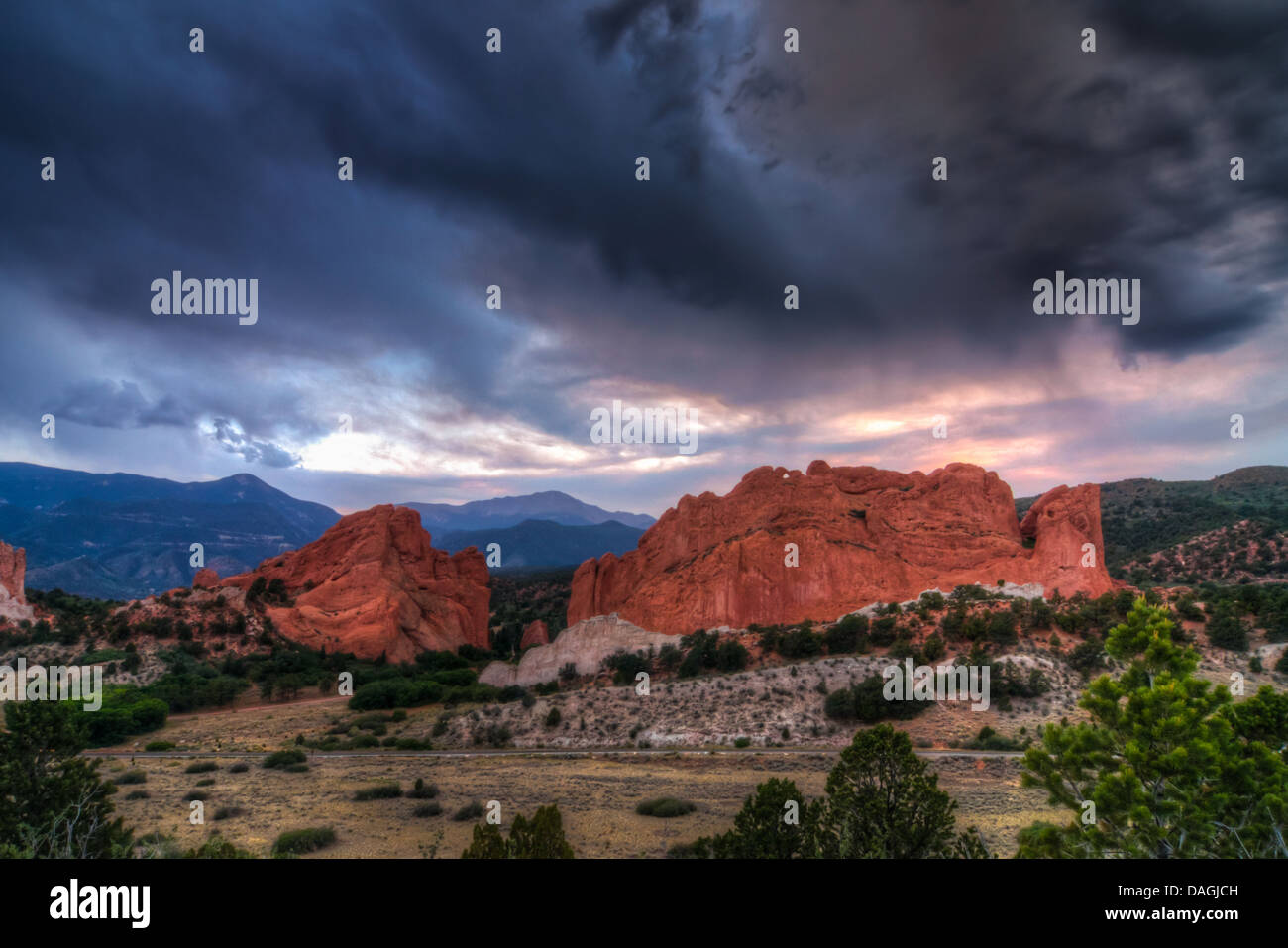 Storm clouds at sunset over Pikes Peak and the red rock formations of Garden of the Gods Park in Colorado Springs, - Stock Image