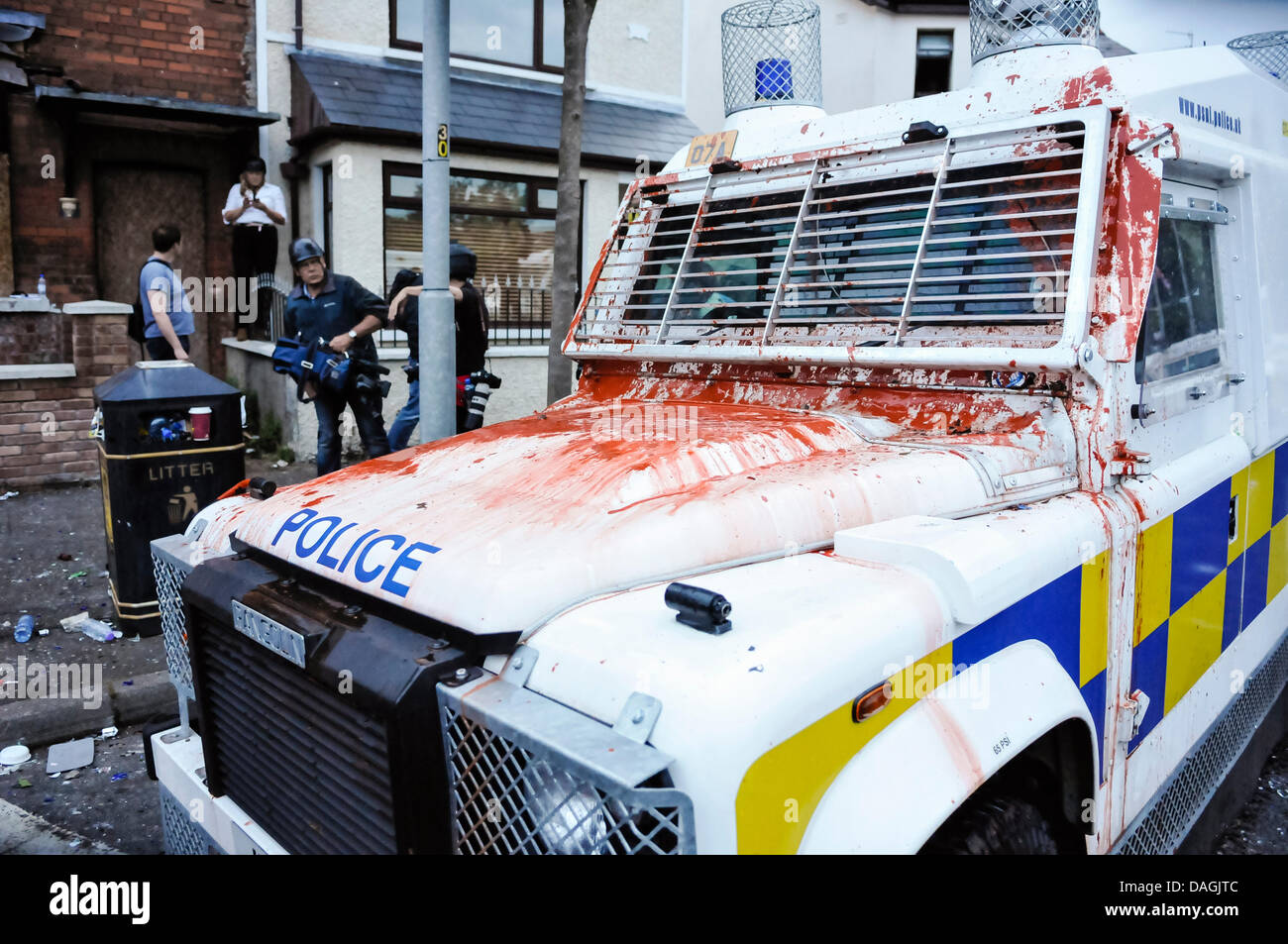 Belfast, Northern Ireland, 12th July 2013 - A PSNI Landrover has paint thrown at it as Loyalists riot on Woodvale - Stock Image