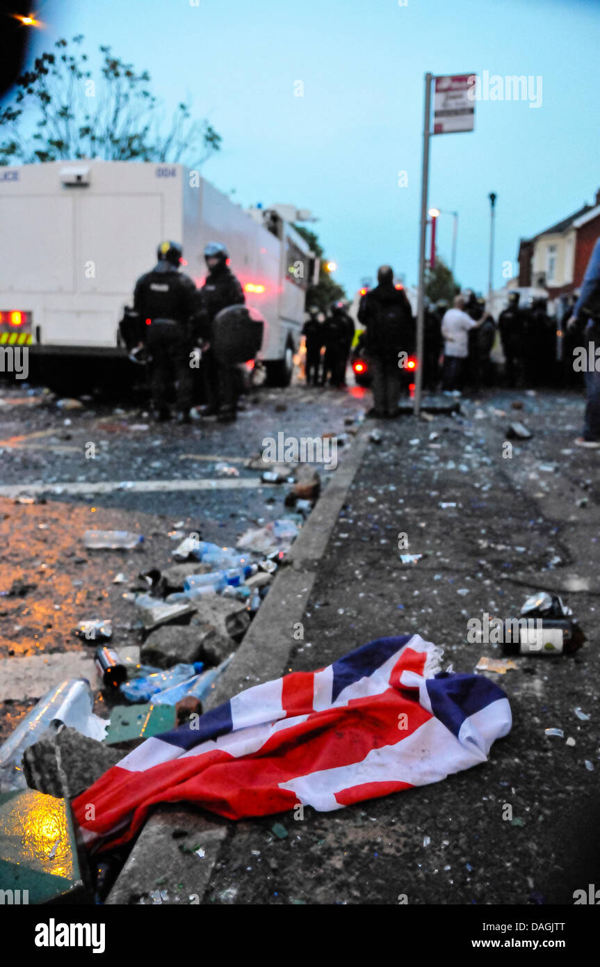 Belfast, Northern Ireland, 12th July 2013 - A discarded Union flag lies on the ground after loyalists riot on the - Stock Image