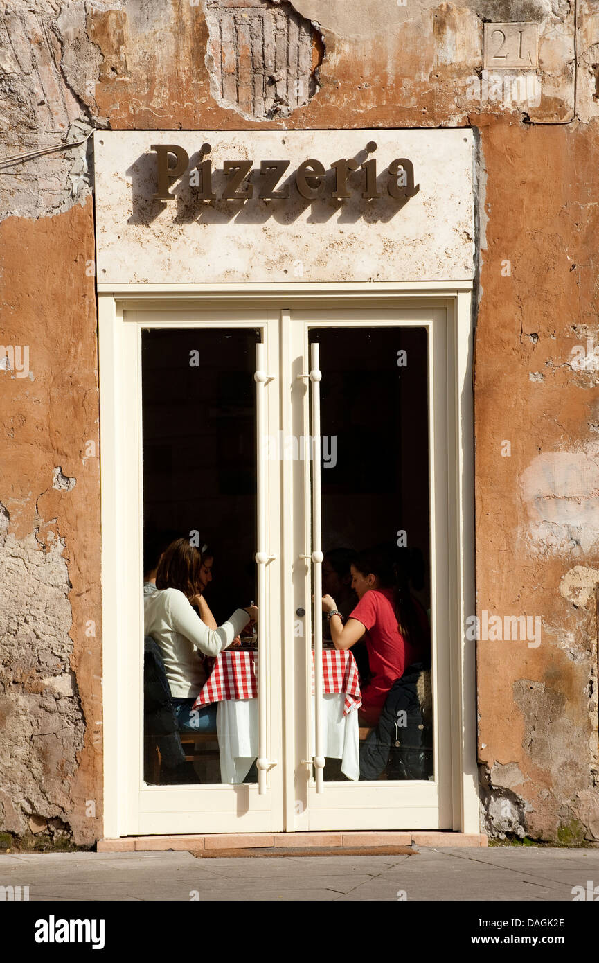 People dining at Pizzeria, restaurant in Rome, Italy - Stock Image
