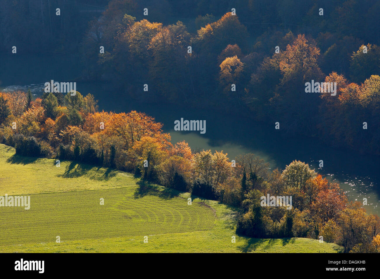 autumn trees on the riverbank, France, Aiguilles d'Arves - Stock Image