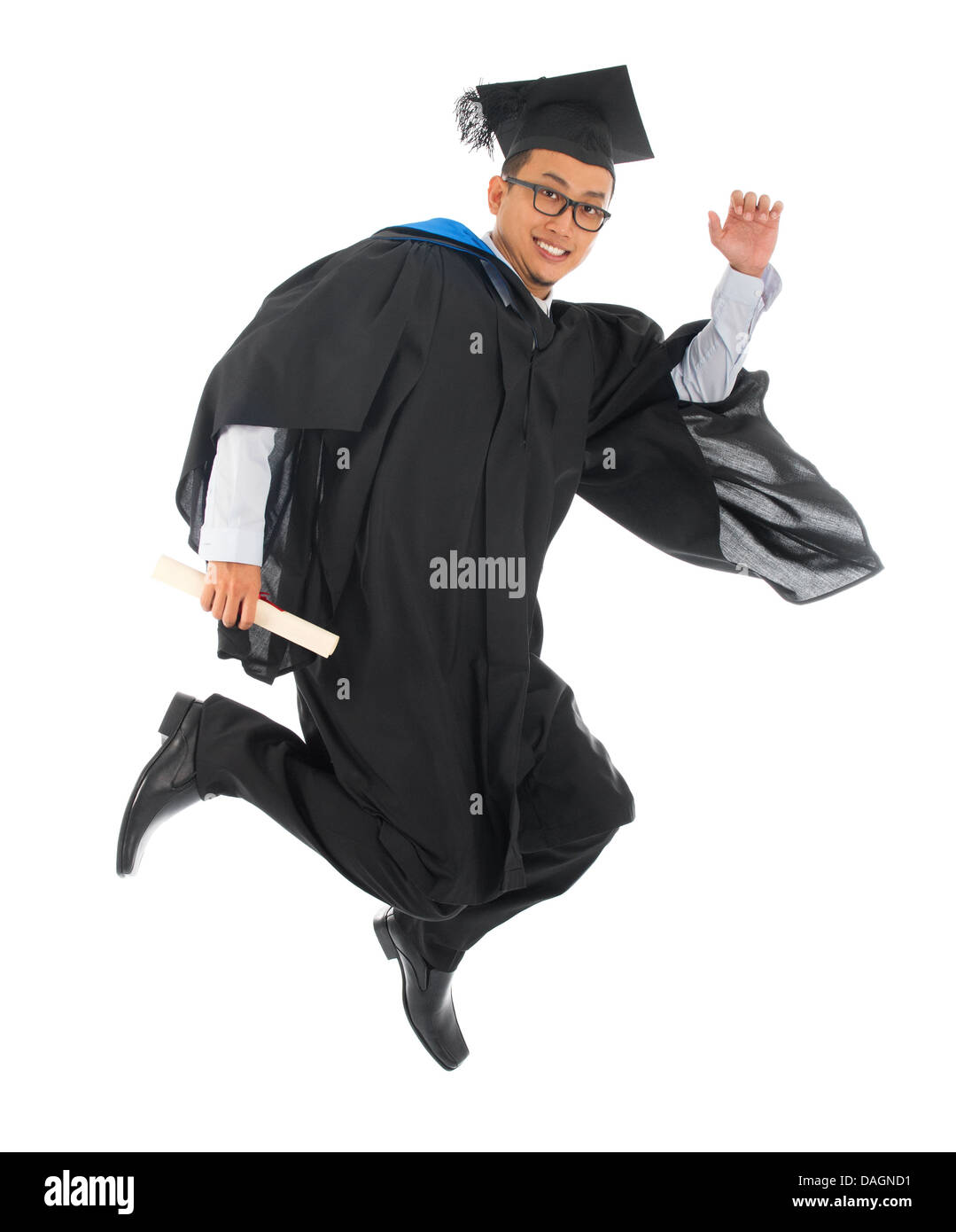 Full body excited Asian male university student in graduation gown ...