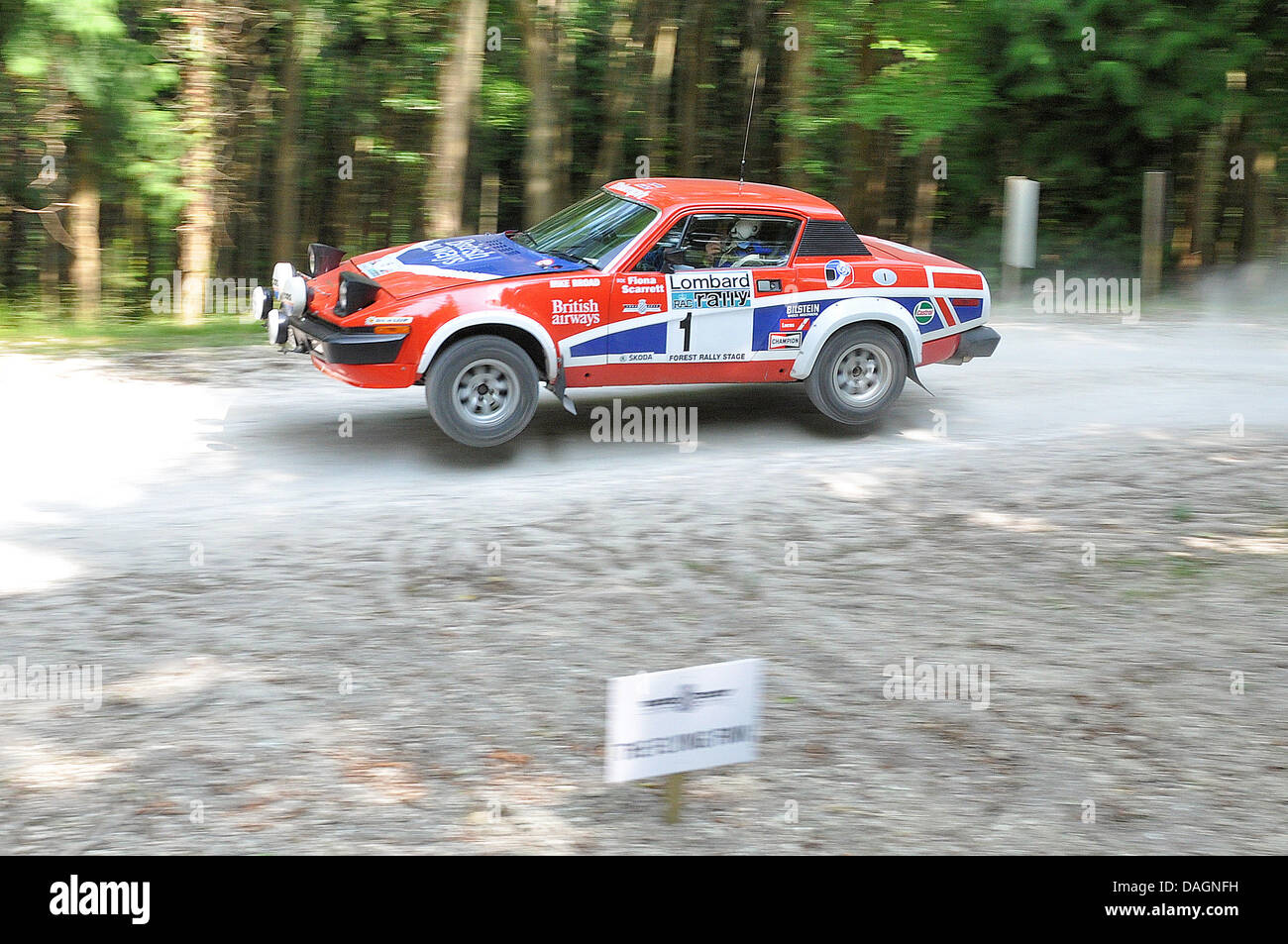 Fiat X1/9 jumping through the forest rally stage. The Goodwood Festival of Speed. Space for copy - Stock Image