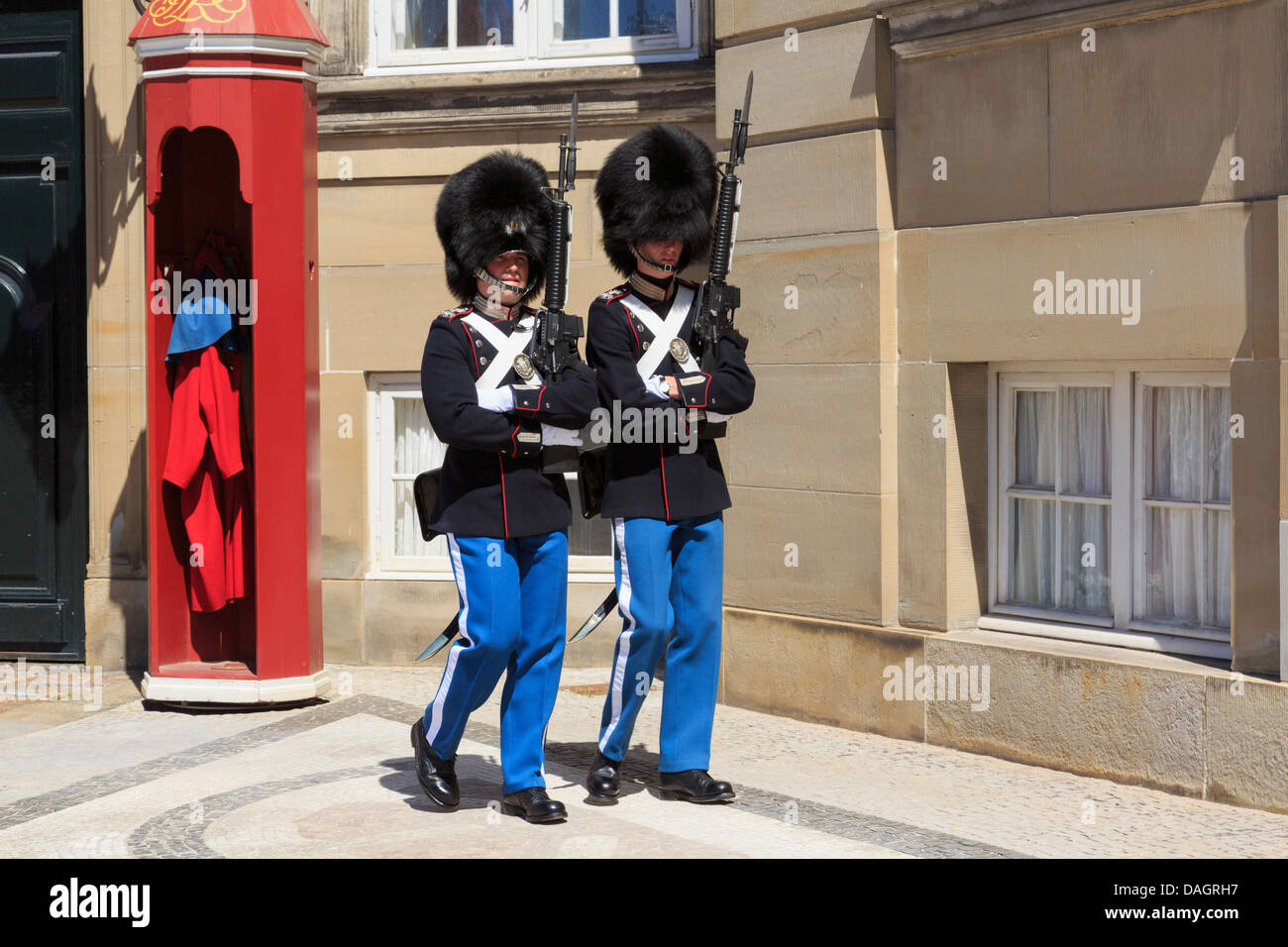 Two Guards on guard duty guarding Amalienborg or Royal Palace official residence of Danish Queen in Copenhagen, - Stock Image