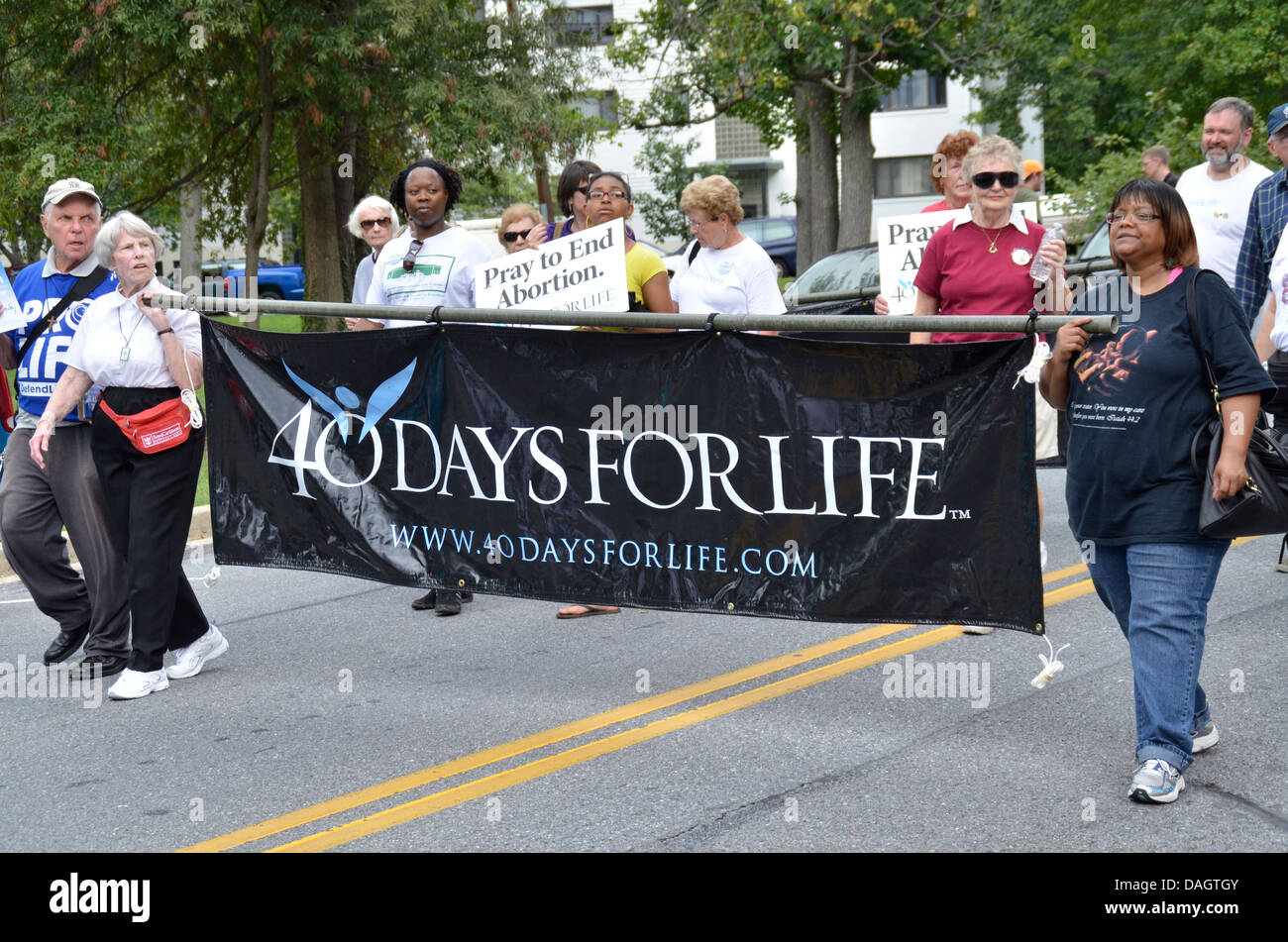 A Pro Life group marches in a Greenbelt Maryland's Labor Day Parade - Stock Image