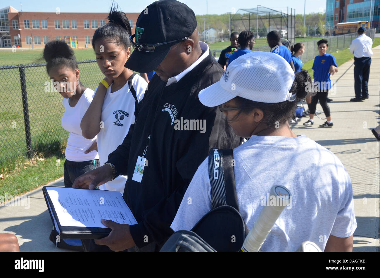coach talking to his high school tennis players before their match inSpringdale, Md - Stock Image