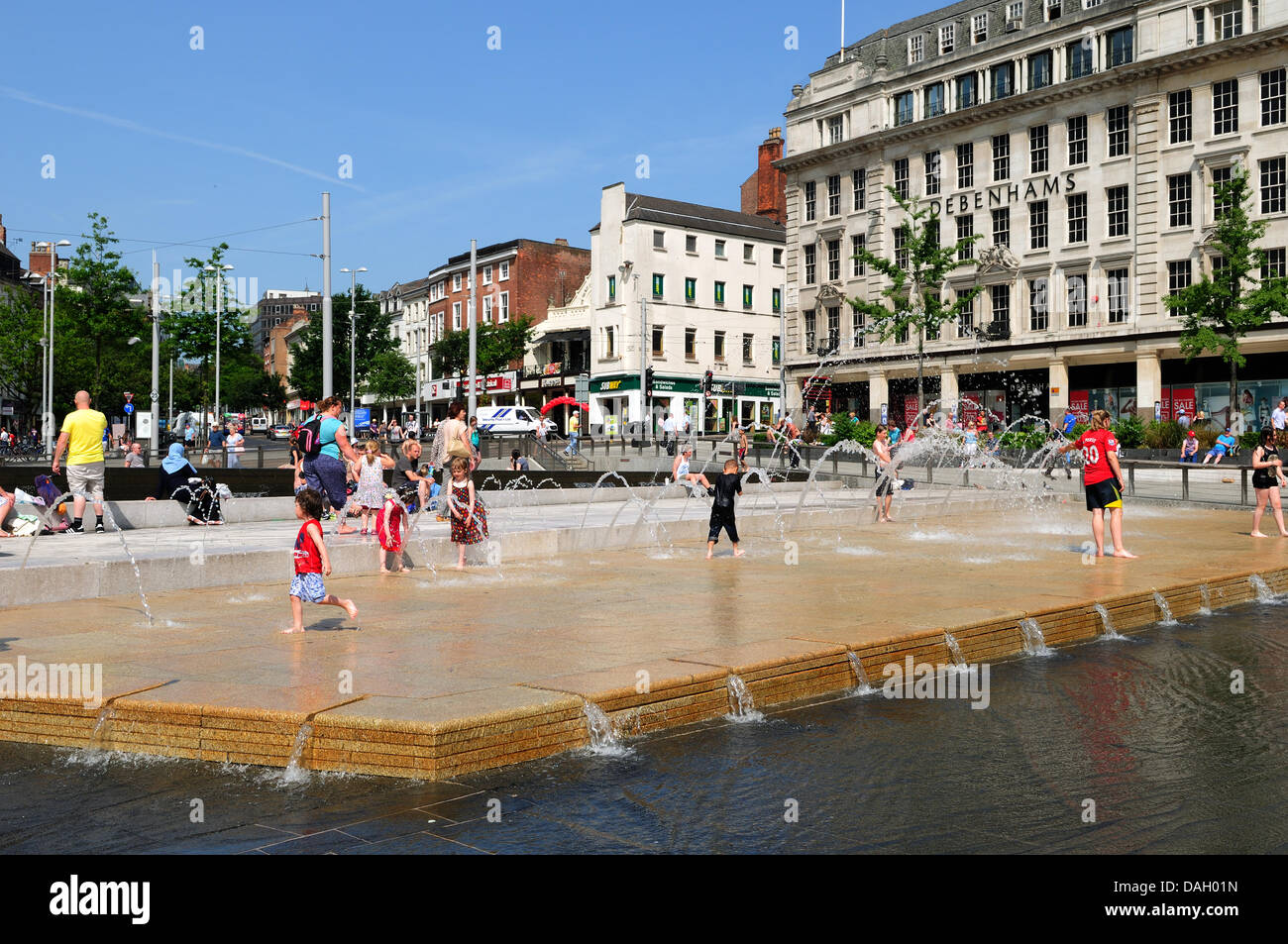 Nottingham 13Th July 2013.People keeping cool during heat wave in the city center. - Stock Image