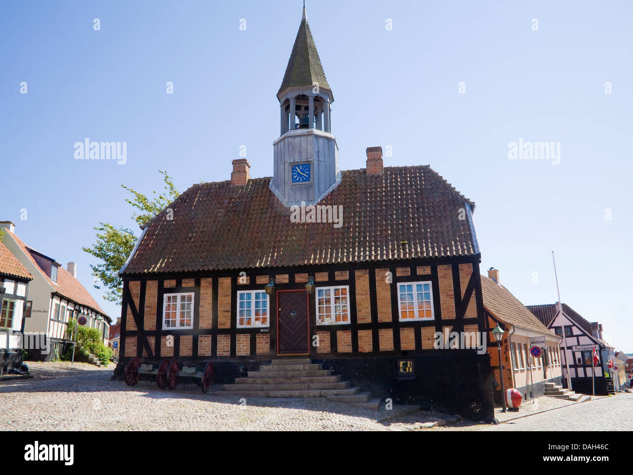 Ebeltoft Denmark EU Town Hall constructed 1789 with church bell tower in cobbled town centre square now museum centuries Stock Photo