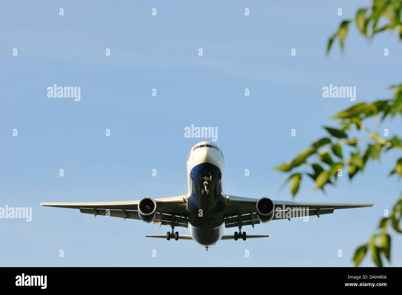 A large aircraft seconds from landing - Stock Image