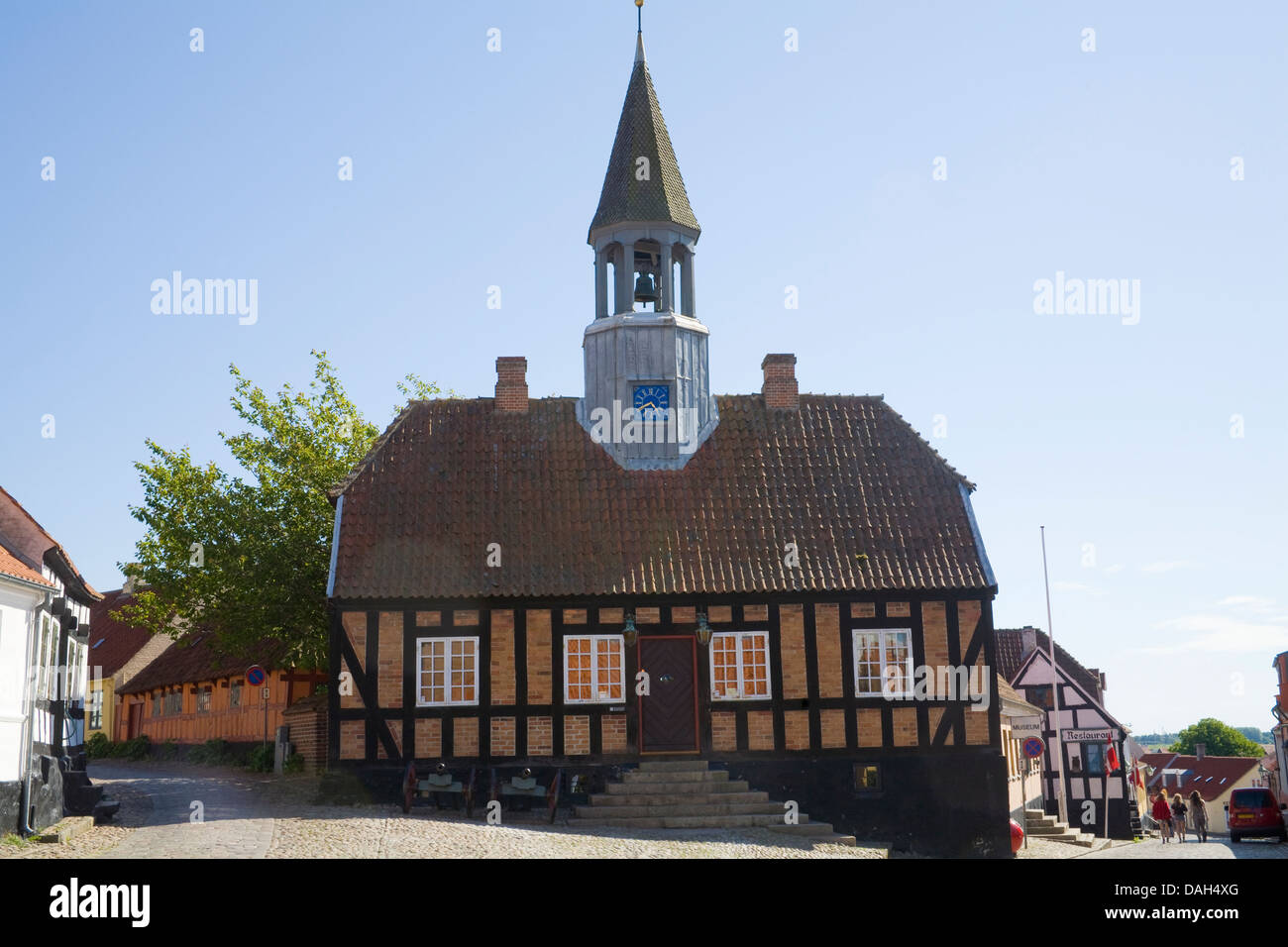 Ebeltoft Denmark EU Town Hall constructed 1789 with church bell tower in cobbled town centre square in Denmarks Stock Photo