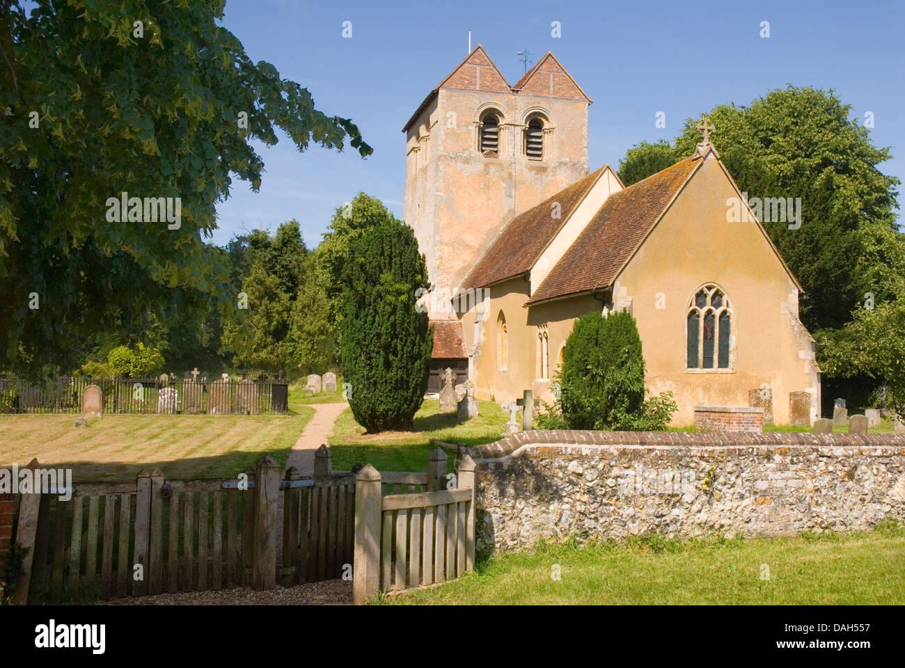 Bucks - Chiltern Hills - Fingest village - Norman church  St Bartholomew - framed by trees - flint boundary walls Stock Photo