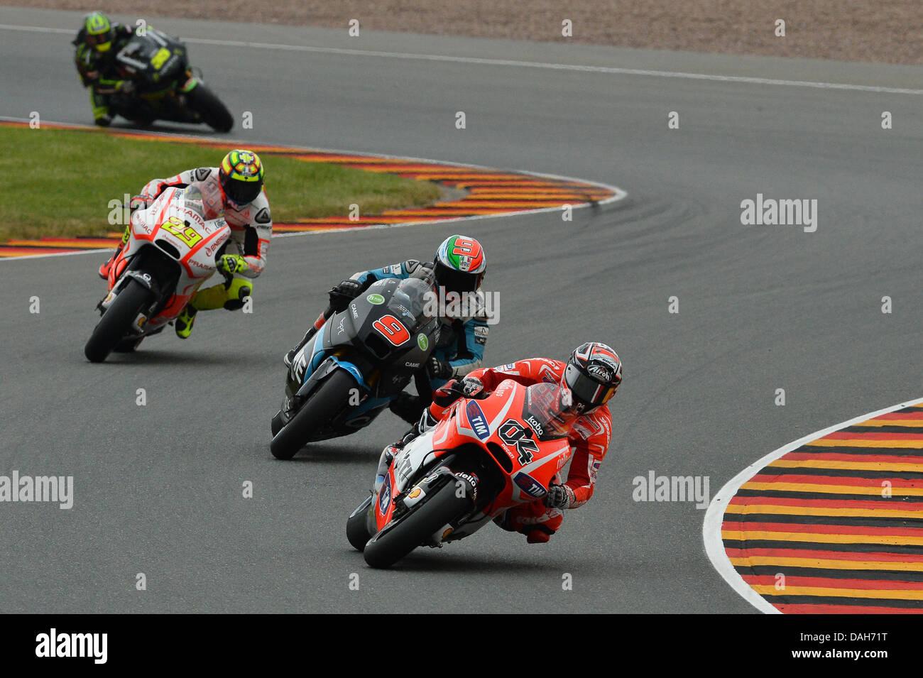 Oberlungwitz, Germany. 13th july 2013. Andrea Dovizioso (Ducati Team) Danilo Petrucci (came iodaracing project) - Stock Image
