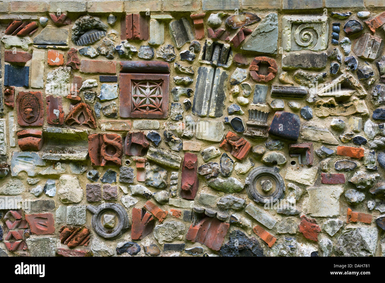 View of the Plantation Garden Norwich, showing the wall constructed from left over bricks. - Stock Image