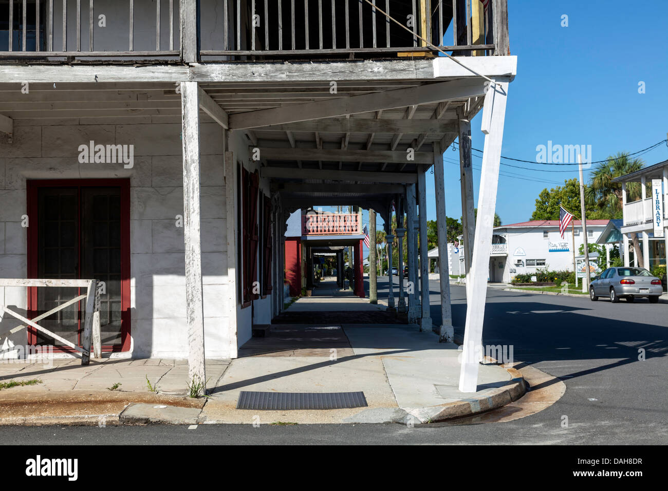Weathered wood frame covered sidewalk at the corner of 2nd and C streets in the historic district of Cedar Key, - Stock Image