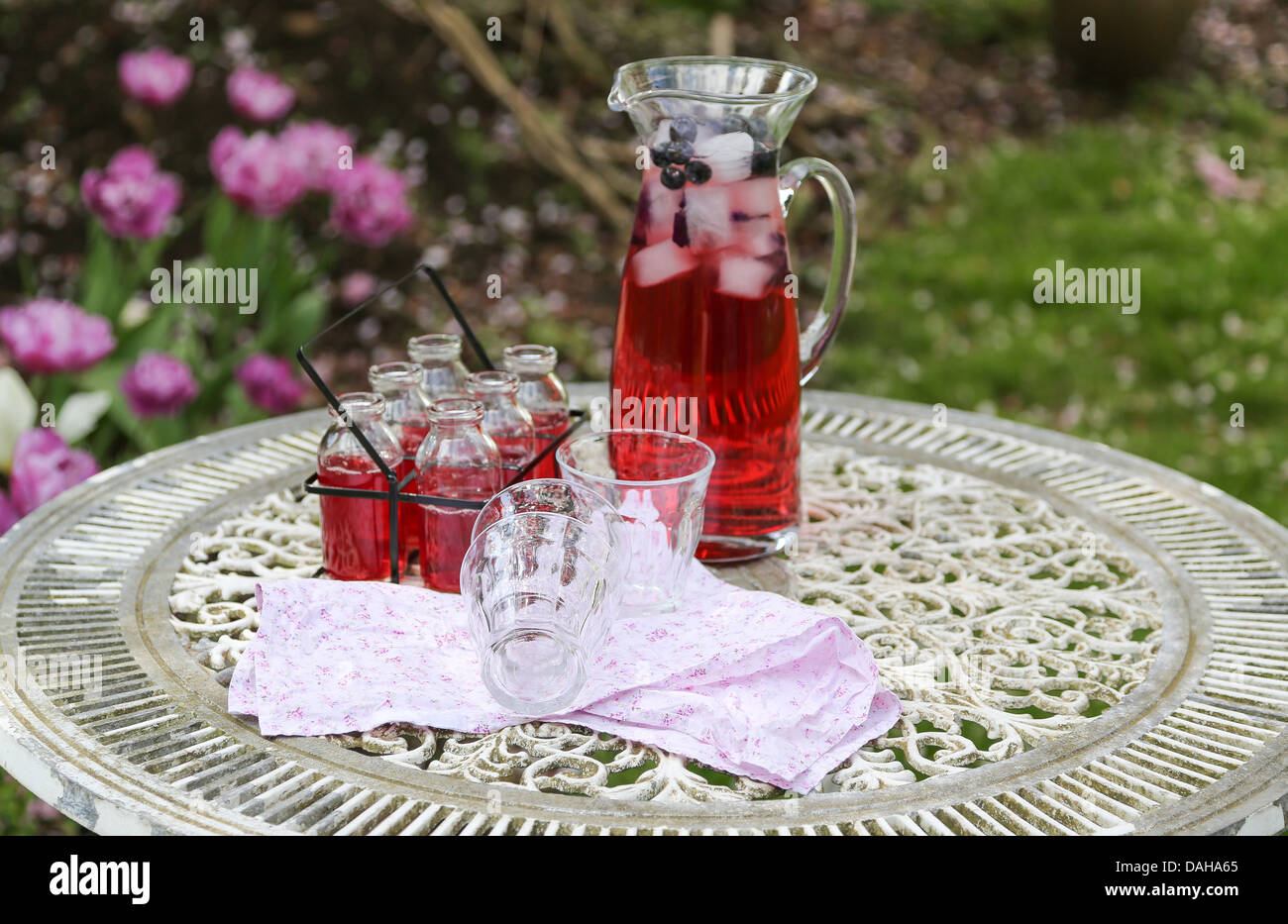 Summer drink of cold red fruit flavour juice - shallow depth of field - Stock Image