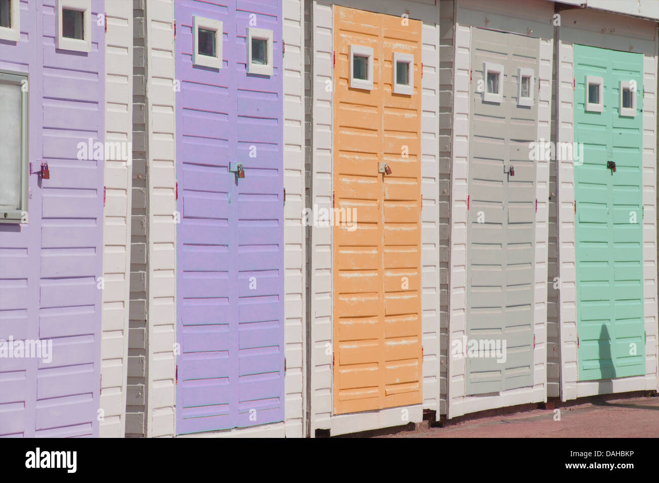 Beach huts on the promenade at Lyme Regis, Dorset, England - Stock Image