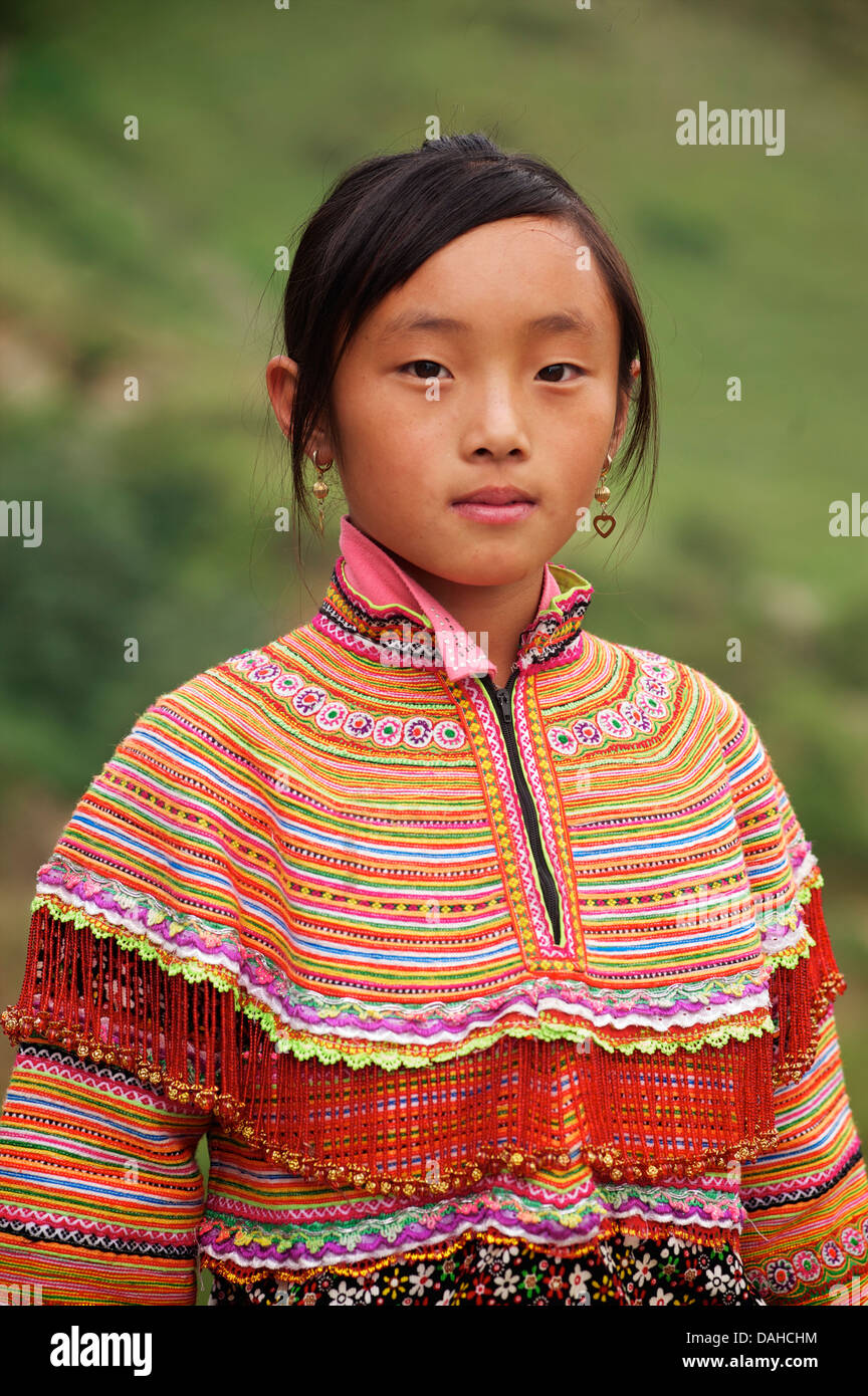 Potrait of a Flower Hmong girl  in her brightly embroidered tribal costume, nr Bac Ha, N Vietnam - Stock Image