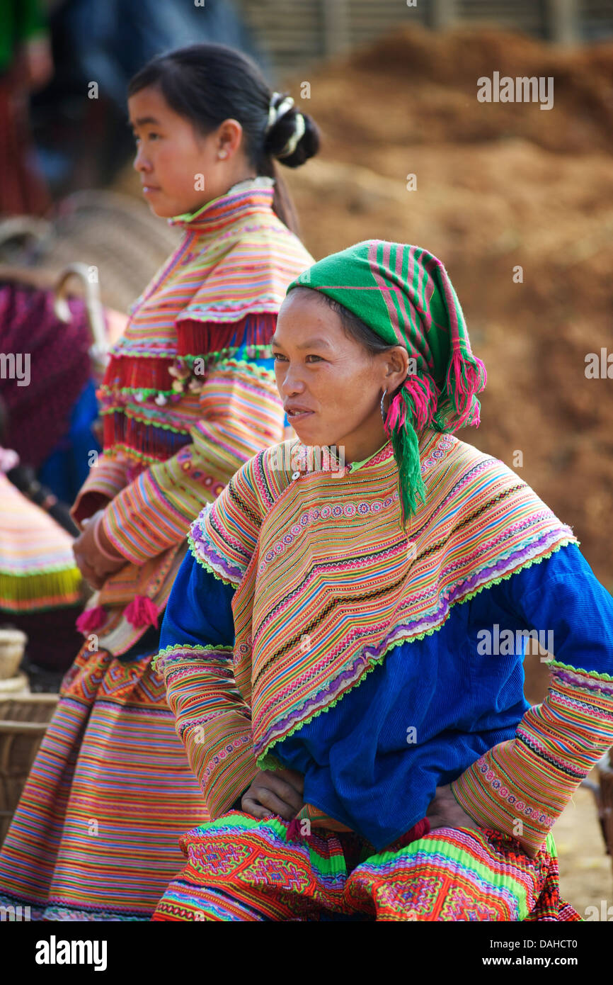 Flower Hmong woman at Can Cau Saturday market. Lao Cai Province, Vietnam. Distinctive tribal costume - Stock Image