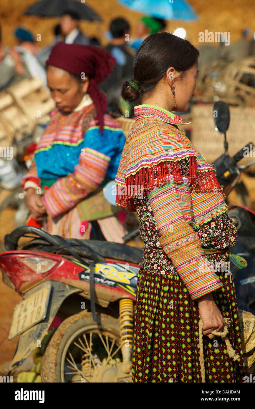 Flower Hmong women in distinctive tribal clothing at  Can Cau market, near Bac Ha. Lao Cai Province, Northern Vietnam - Stock Image