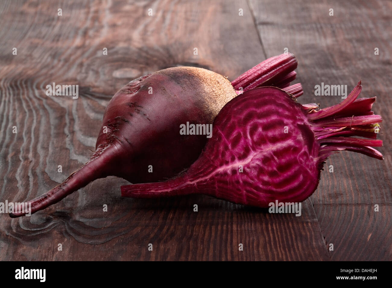 ripe beets on a wooden table - Stock Image