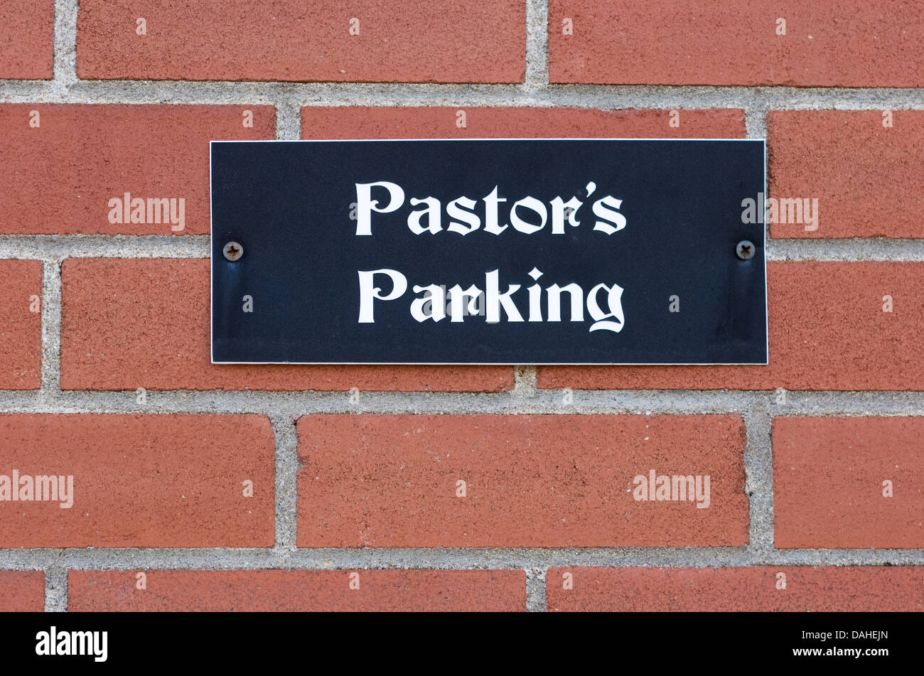 Sign outside a church for a parking space: Pastor's Parking.  At the Fourth Avenue Baptist Church, Ottawa, Ontario, - Stock Image