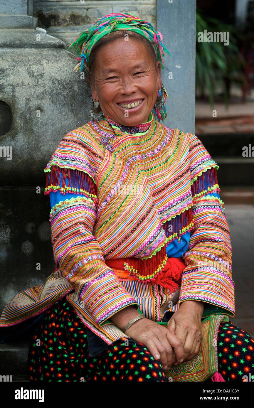 Portrait of a Flower Hmong woman in distinctive tribal costume, Bac Ha, Vietnam - Stock Image