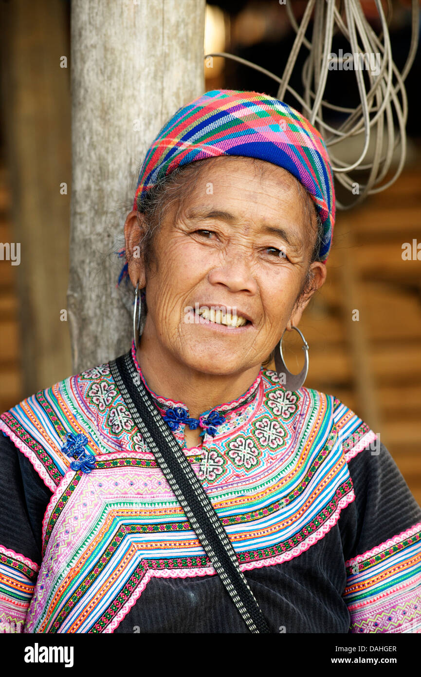 Potrait of a Flower Hmong woman in her brightly embroidered tribal costume, Bac Ha, N. Vietnam - Stock Image
