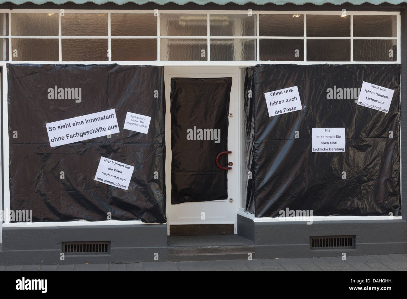 Retail dealers cover showcases to demonstrate against online dealers, Toenisvorst, Germany. Stock Photo