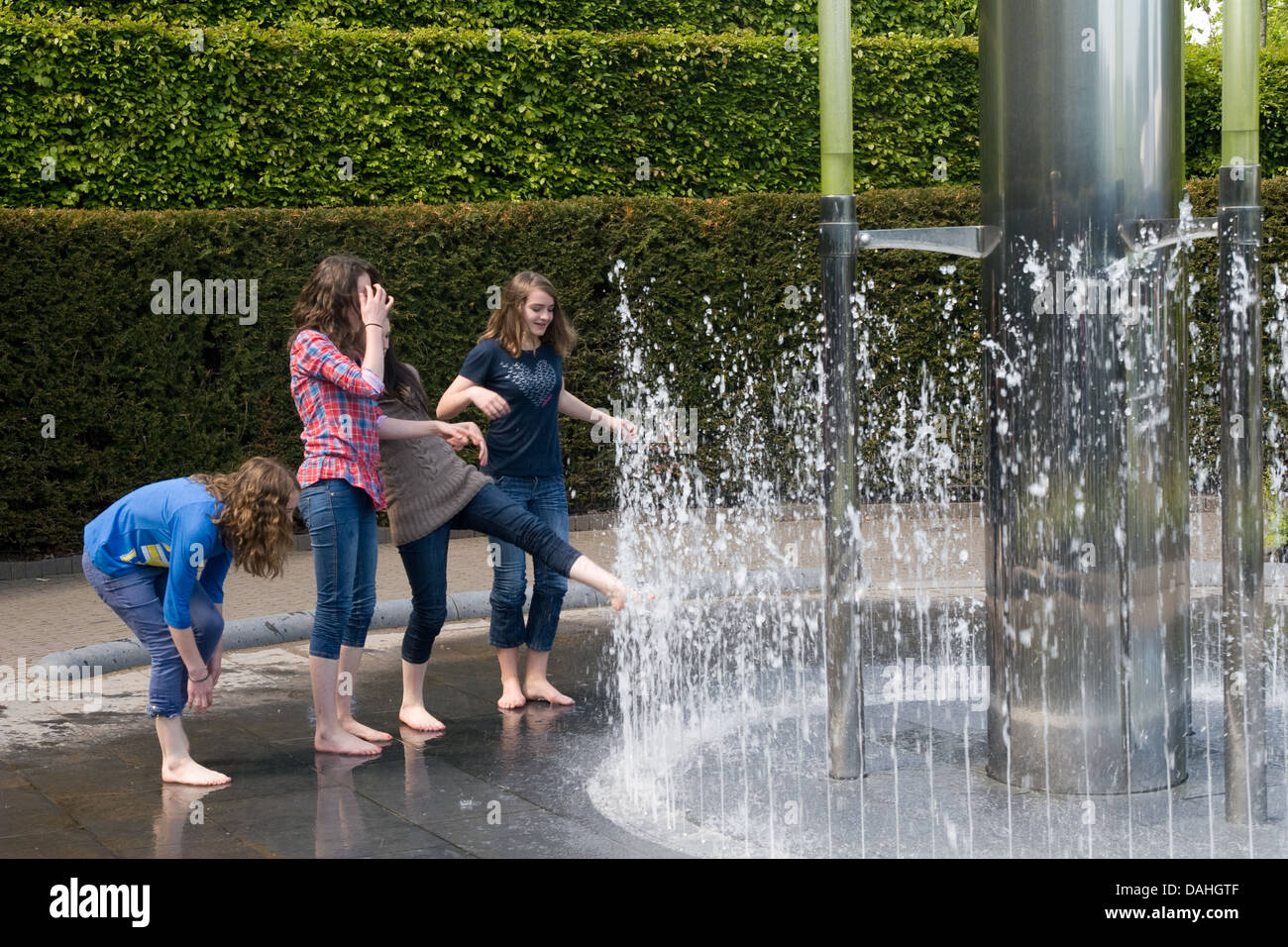Teenage Girls Play In Water Fountain At Alnwick Castle