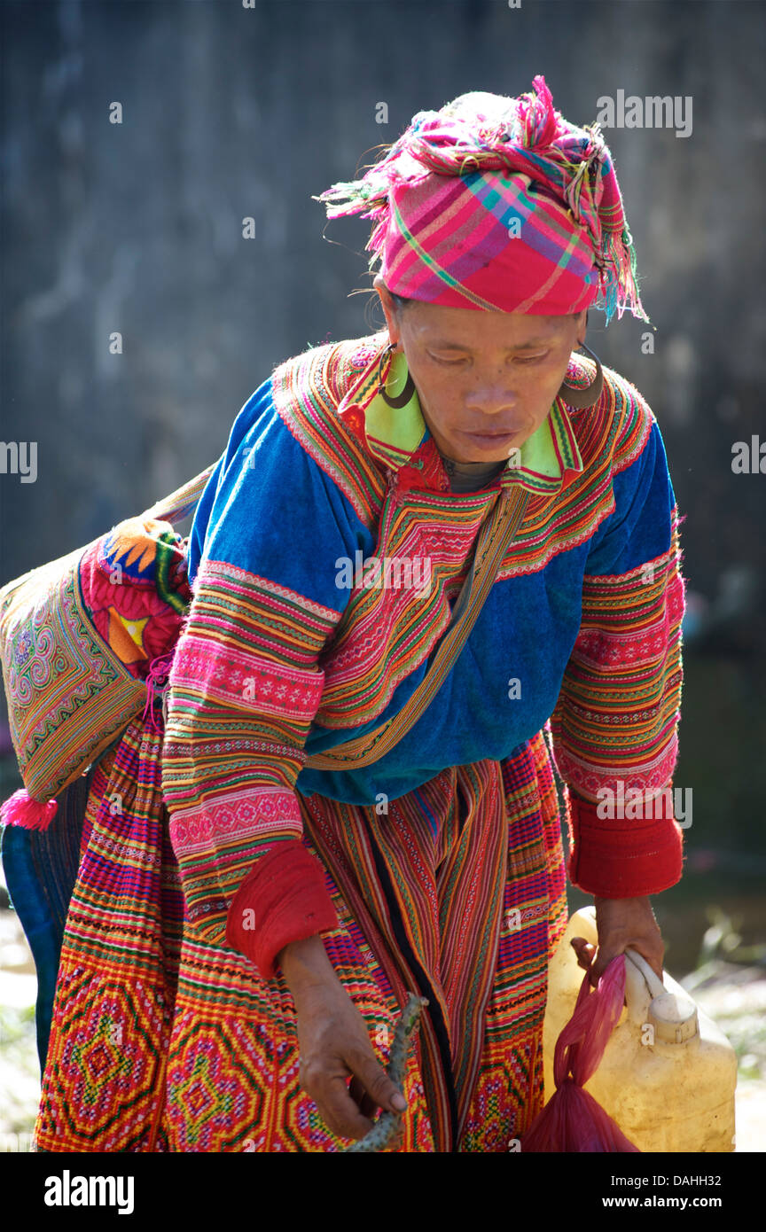 Flower Hmong woman at Coc Ly market Stock Photo