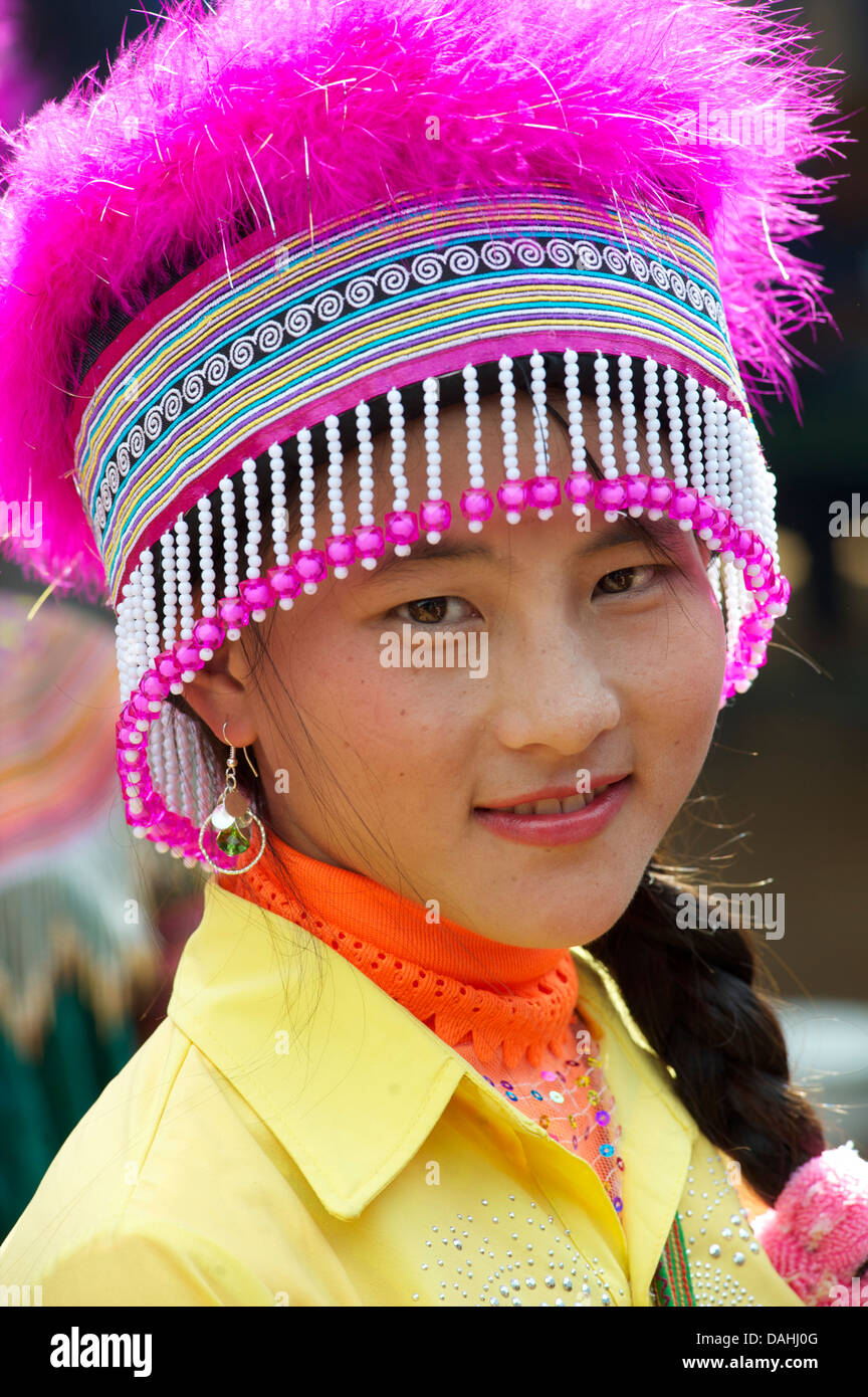 Potrait of a young Flower Hmong woman in distinctive headdress, Coc Ly market, N Vietnam. Model Released - Stock Image