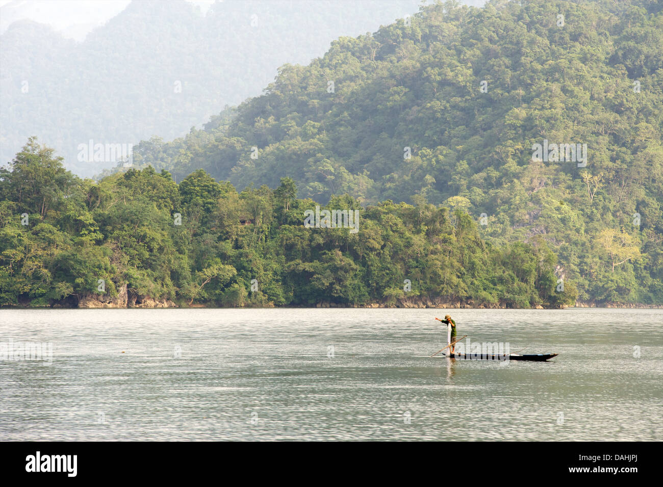Fishing from a canoe with nets. Ba Be lake is the largest natural lake in Vietnam.  Bac Kan Province. Northeast - Stock Image