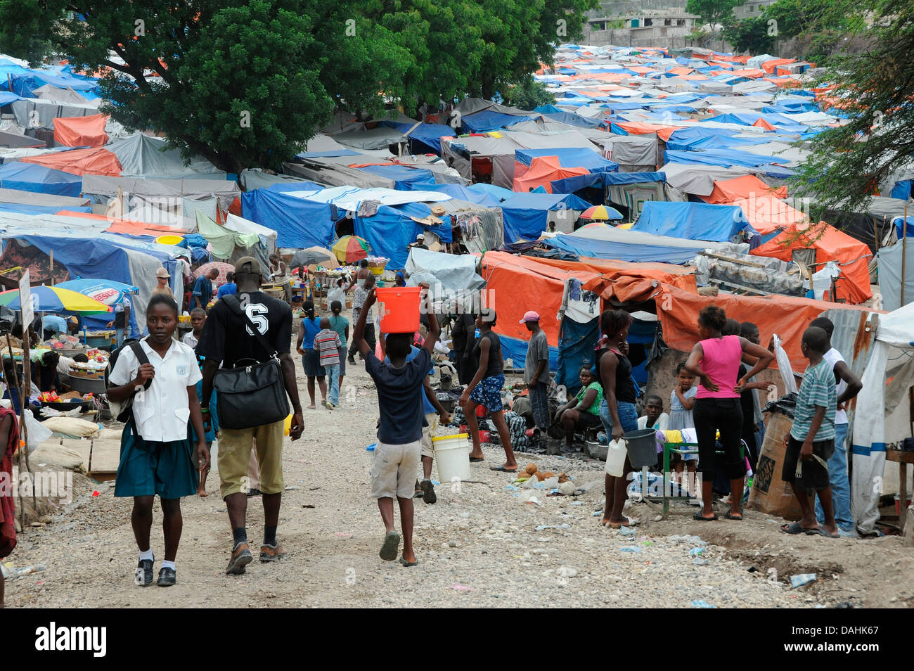 Haitians return to normalcy at the Petionville refugee camp in the aftermath of the 7.0 magnitude earthquake that - Stock Image