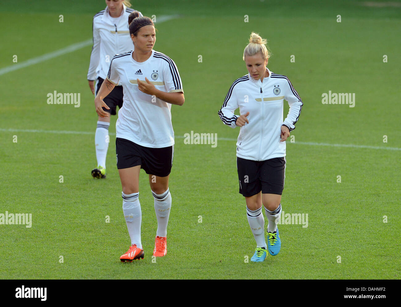 Germany's Dzsenifer Marozsan (L) and Svenja Huth take part in the final training session during the UEFAWomen's - Stock Image