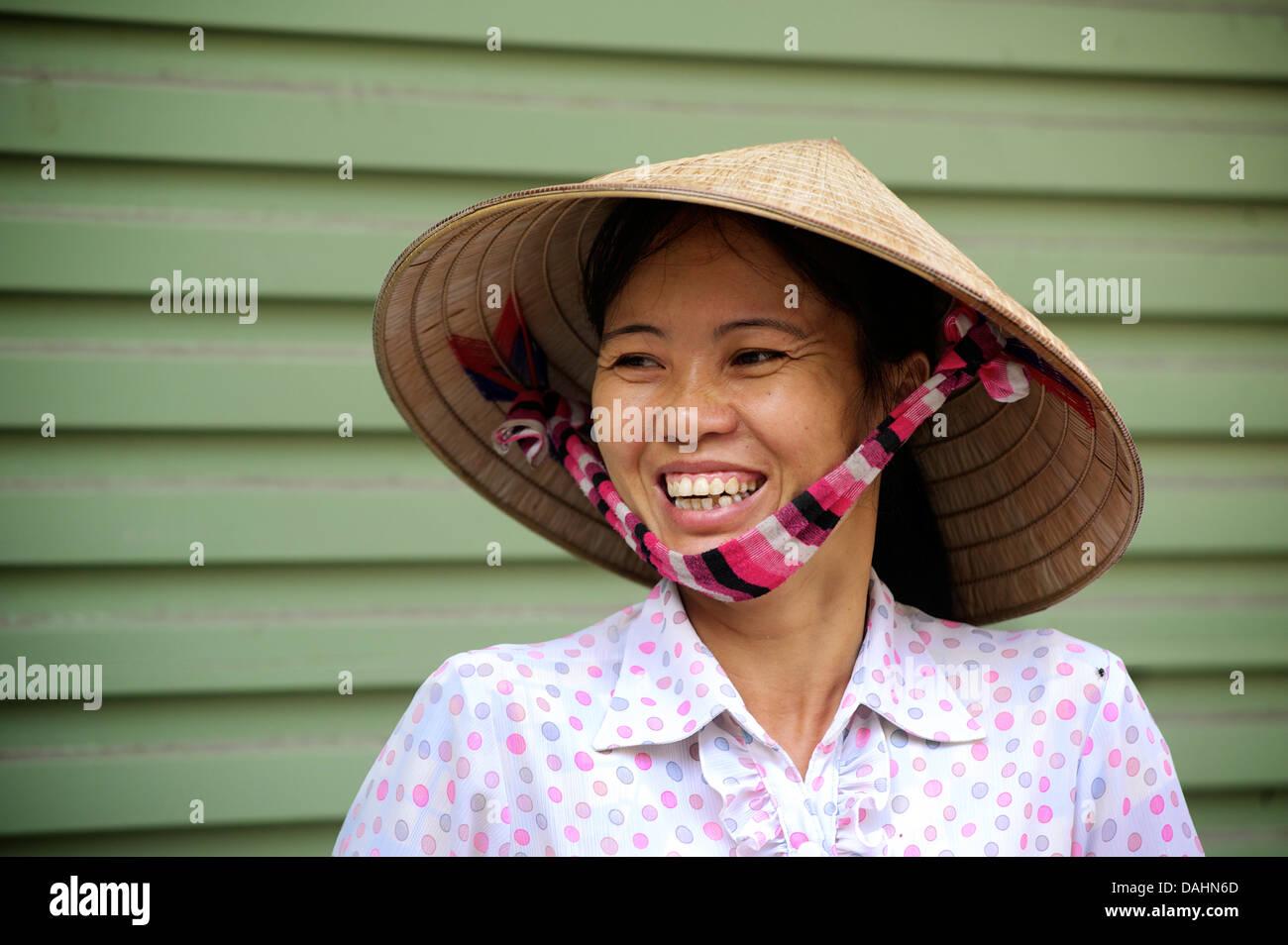 Portrait of a snack vendor in distinctive hat, Hanoi. MODEL RELEASED - Stock Image
