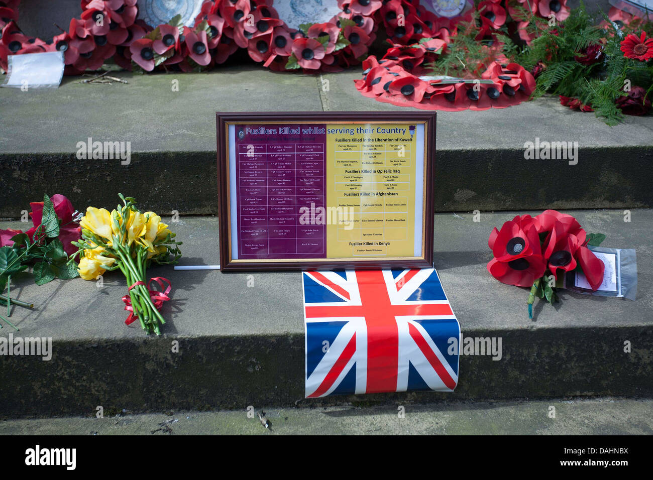 union jack flag and tribute at Cenotaph , St Peter's Square , Manchester - Stock Image