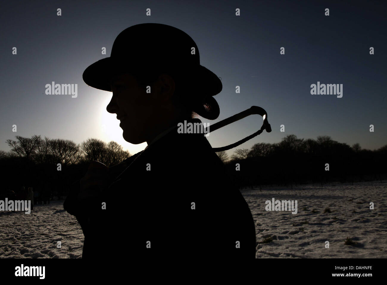 silhouette of fox hunt participant - Stock Image