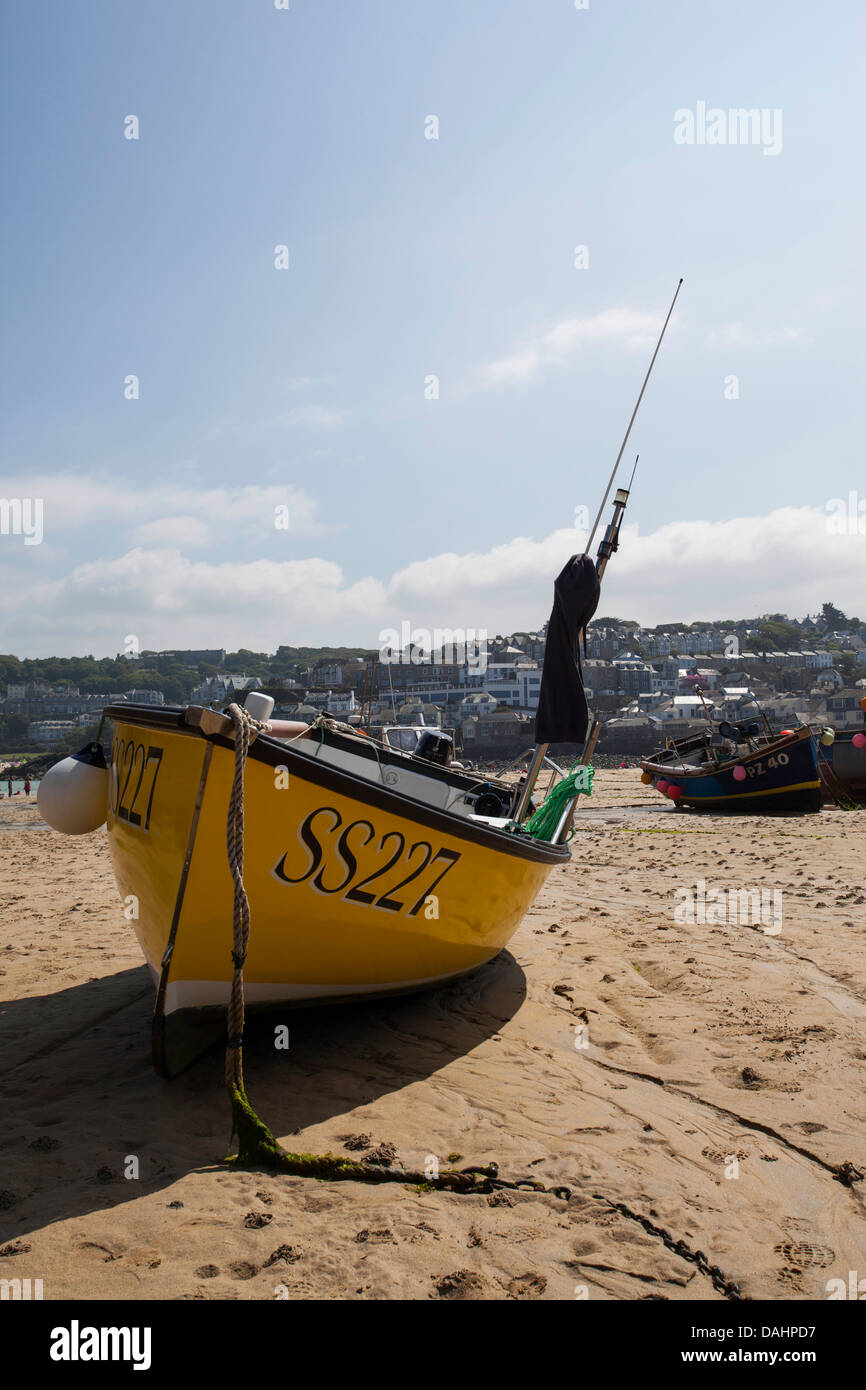 A fishing boat at low tide in St Ives harbour Cornwall Stock Photo