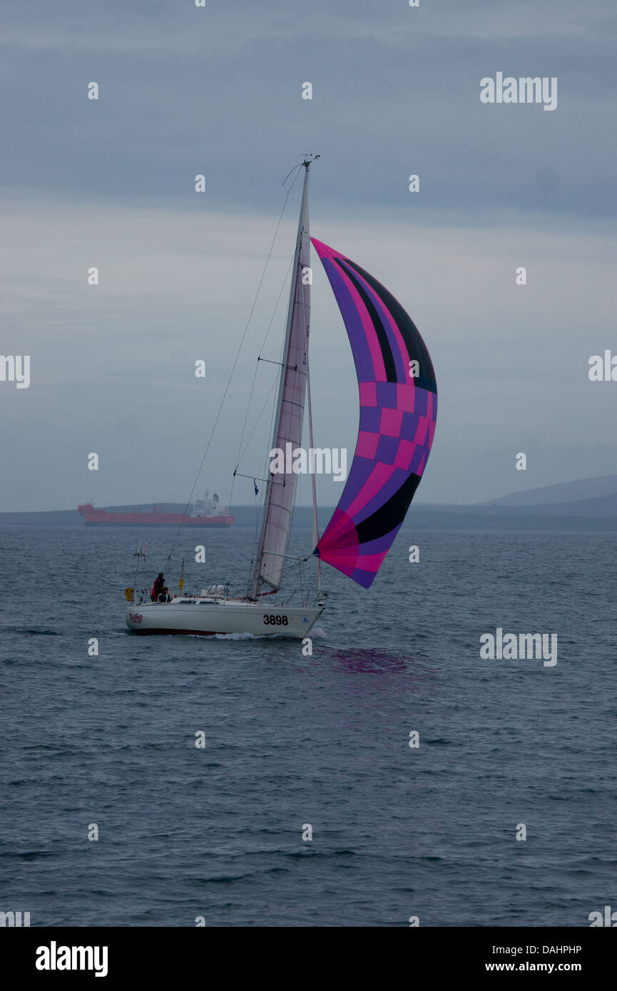 A yacht heading for Lerwick harbour - Stock Image