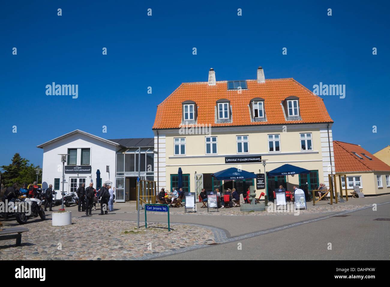 Lokken Denmark EU Visitors at fish restaurant dining out in sunshine in seaside resort on North West Jutland coast - Stock Image