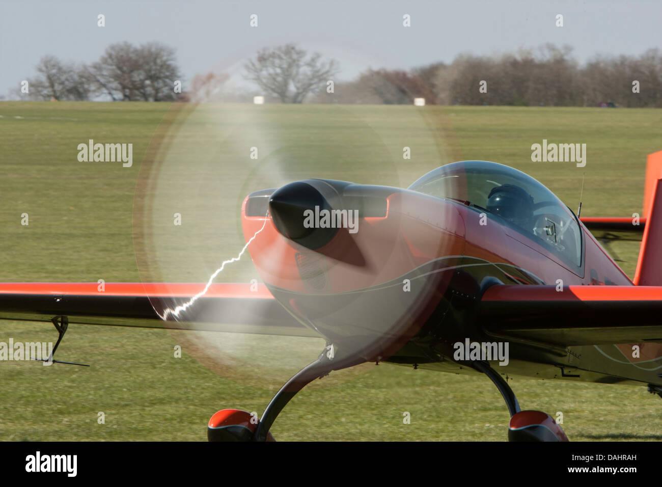 Extra EA-300L, part of 'The Blades' aerobatic team based at Sywell Aerodrome, Northampton, England - Stock Image
