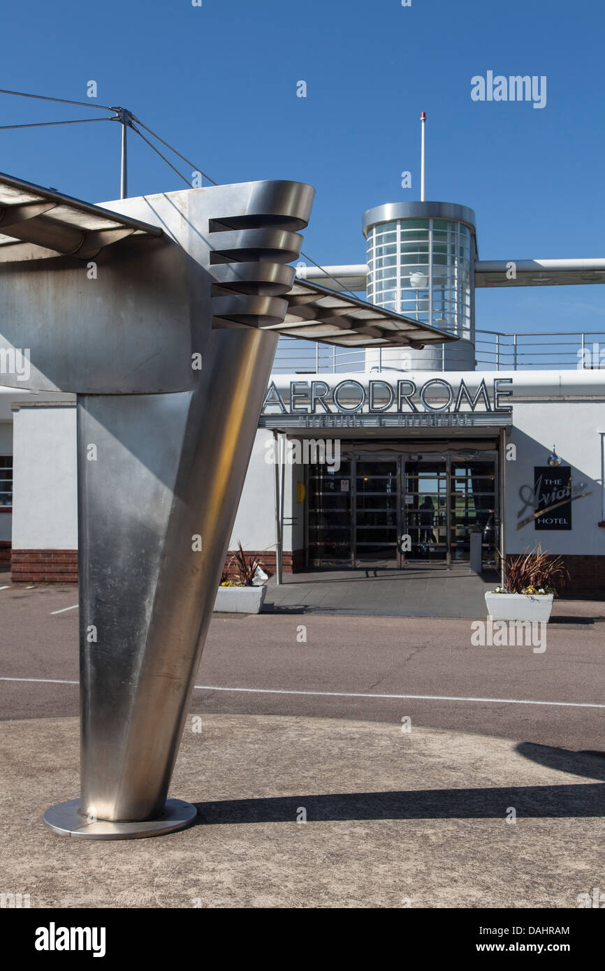 Art Deco sculpture in front of airport entrance, Sywell Aerodrome, Northampton, England - Stock Image