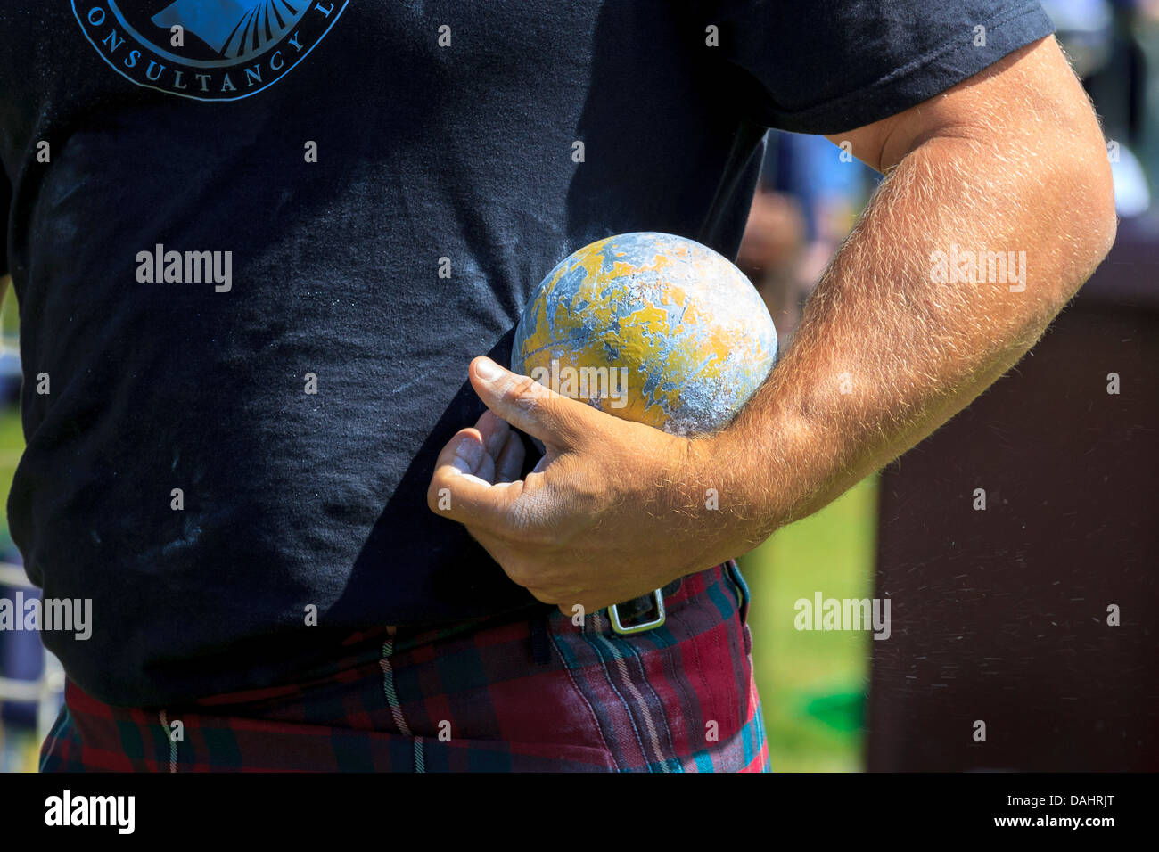 Competitor holding the 16 pound ball in the traditional Scottish competition at the Highland Games - Stock Image